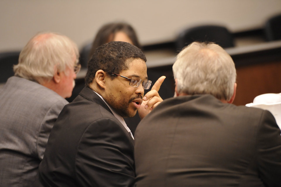 File - In this April 22, 2013 file photo, Bartholomew Granger, center, is flanked by attorneys James Makin, right, and Sonny Cribbs before the start of his trial in Galveston, Texas. Granger, convicted of fatally shooting of a 79-year-old woman outside a Southeast Texas courthouse last year has been sentenced to death.  (AP Photo/The Beaumont Enterprise, Dave Ryan)