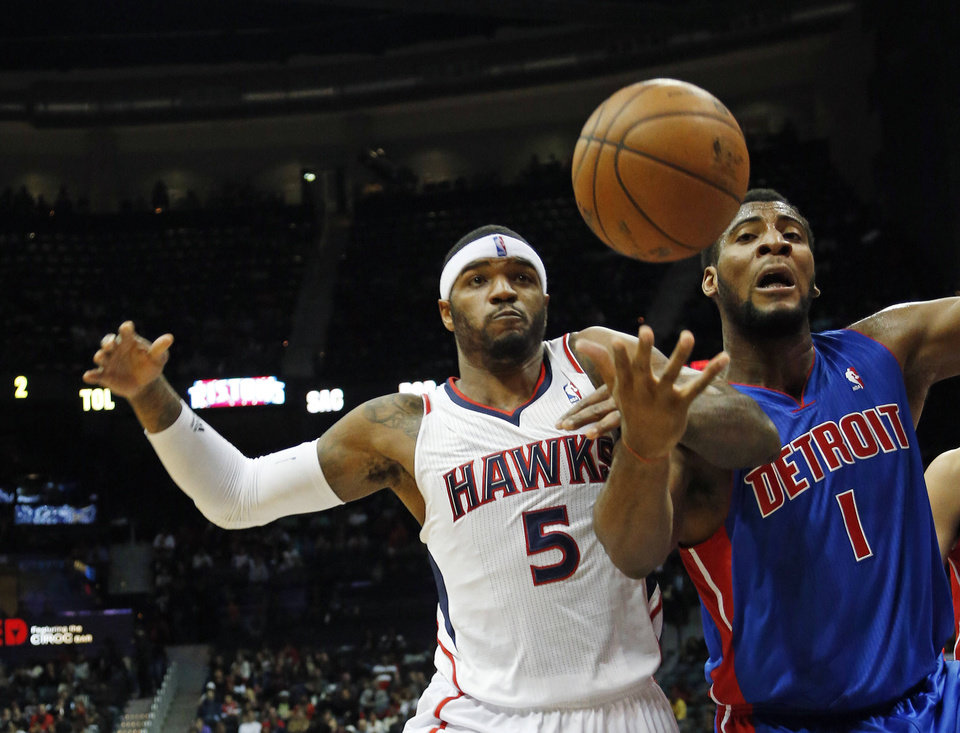 Photo - Atlanta Hawks small forward Josh Smith (5) battles Detroit Pistons center Andre Drummond (1) for a rebound in the first half of an NBA basket ball game on Wednesday, Dec. 26, 2012, in Atlanta. (AP Photo/John Bazemore)