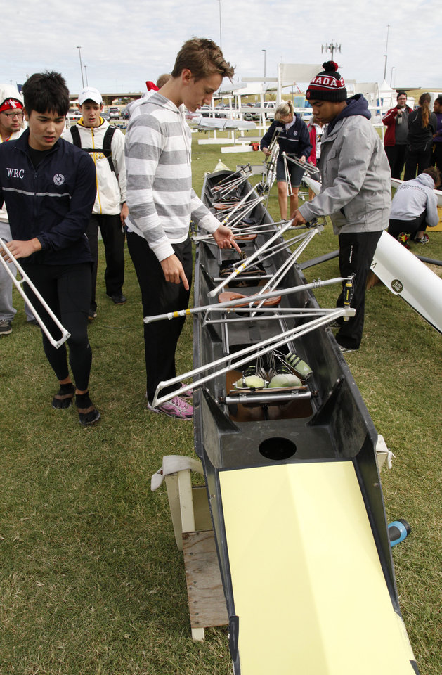 Photo - Members of the Winnipeg Rowing Club prepare their rowing shell during the Oklahoma Regatta Festival on the Oklahoma River in Oklahoma City, OK, Saturday, October 5, 2013,  Photo by Paul Hellstern, The Oklahoman