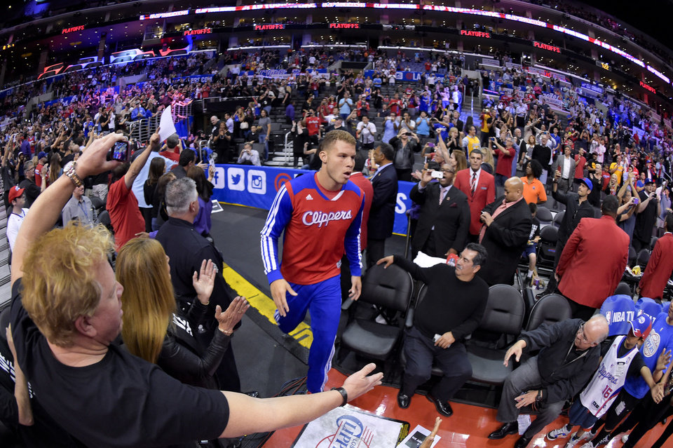Photo - Los Angeles Clippers forward Blake Griffin comes onto the court before Game 5 of the Clippers' opening-round NBA basketball playoff series against the Golden State Warriors on Tuesday, April 29, 2014, in Los Angeles. (AP Photo)