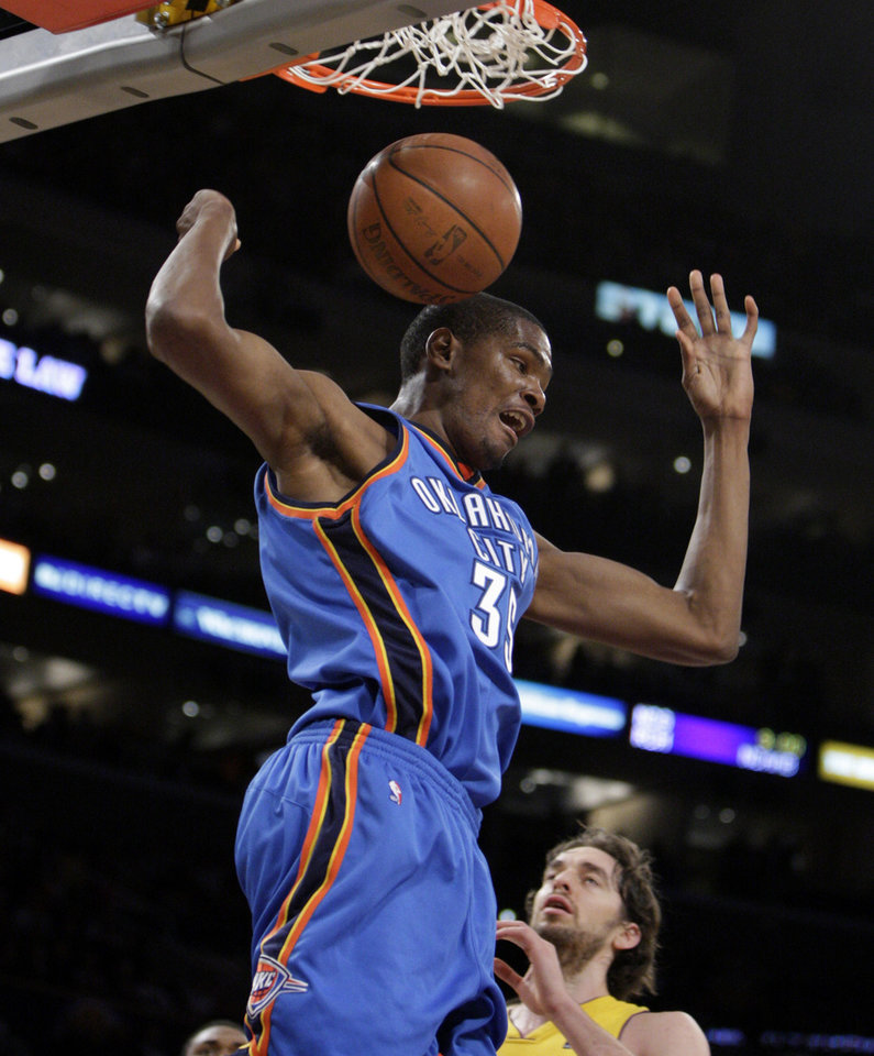 Photo - Oklahoma City Thunder's Kevin Durant dunks as Los Angeles Lakers' Pau Gasol, of Spain, bottom, looks on during the first half of their NBA basketball game in Los Angeles, Tuesday, Dec. 22, 2009. (AP Photo/Jae C. Hong) ORG XMIT: LAS102