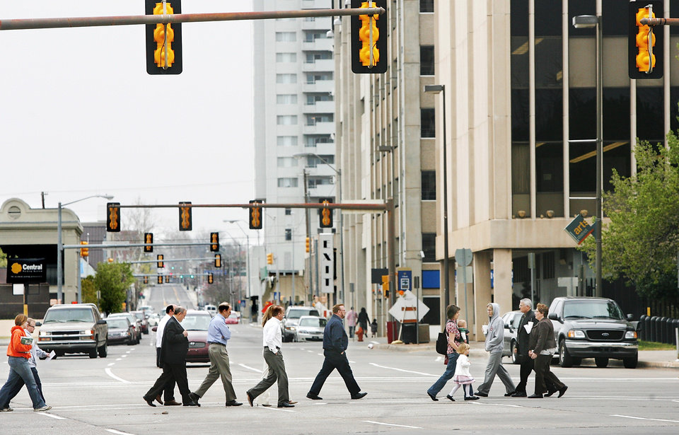 Photo - Pedestrians cross Hudson Avenue, which at six-lanes wide is ranked among the worst downtown streets for walkability by consultant Jeff Speck.  Photo by Jim Beckel, The Oklahoman