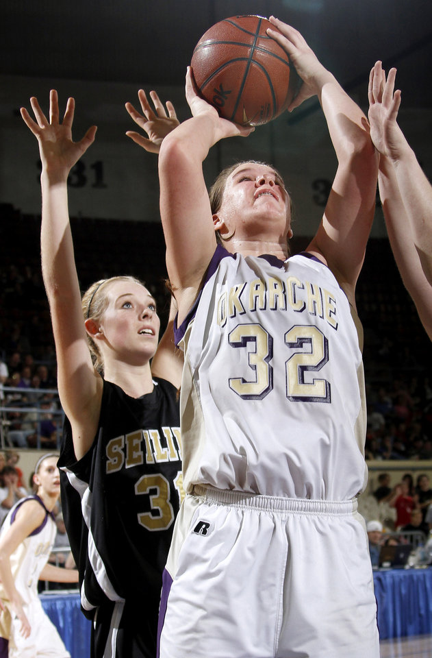 Photo - Okarche's Megan Schaefer shoots the ball in front of Seiling's Chelsie Livingston during the Class A girls basketball state tournament at the State Fair Arena in Oklahoma City, Friday, March 5, 2010.  Photo by Bryan Terry, The Oklahoman