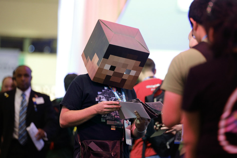 Photo - Fans of Minecraft have shown their love of the game with costumes and other gear, such as this Minecraft-themed mask worn by Jonny Rice during the Electronic Entertainment Expo in June in Los Angeles. AP PHOTO/ JAE C. HONG   Jae C. Hong - AP PHOTO/ JAE C. HONG