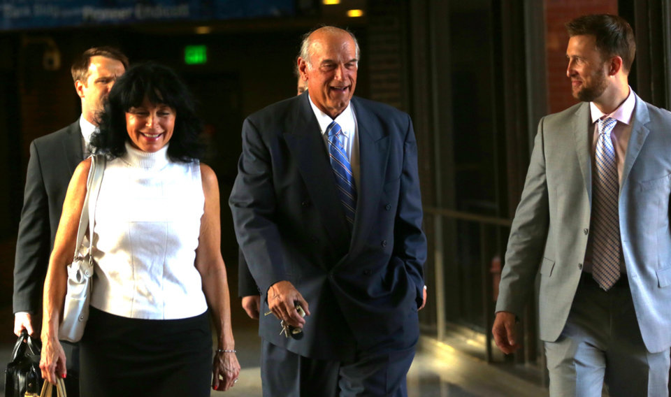 Photo - FILE - In this July 22, 2014 file photo former Minnesota Gov. Jesse Ventura, center, arrives at court with his wife, Terry, and others for his defamation lawsuit against