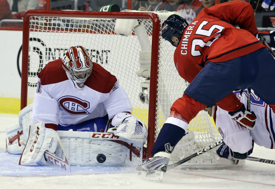 Montreal Canadiens goalie Carey Price (31) blocks a shot by Washington Capitals left wing Jason Chimera (25) in the first period of an NHL hockey game on Thursday, Jan. 24, 2013, in Washington. (AP Photo/Alex Brandon)