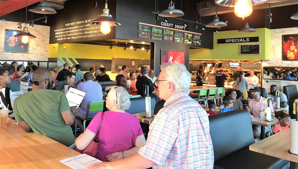 Photo -  Hopdoddy Burger Bar opened Monday in Nichols Hills Plaza. [Photo by Dave Cathey, The Oklahoman]