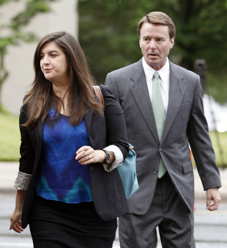 Photo -   Cate Edwards leads her father, John Edwards, into the federal courthouse in Greensboro, N.C., as the defense starts in his campaign corruption trial, Monday, May 14, 2012. (AP Photo/Bob Leverone)