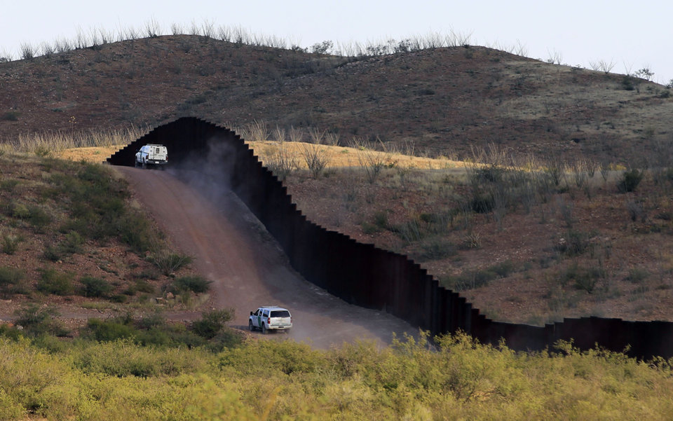Photo -   U.S. Border Patrol agents patrol the border fence near where a U.S. Border Patrol agent Nicholas Ivie was shot and killed, and one other was shot and injured, Tuesday, Oct. 2, 2012, in Naco, Ariz. (AP Photo/Ross D. Franklin)
