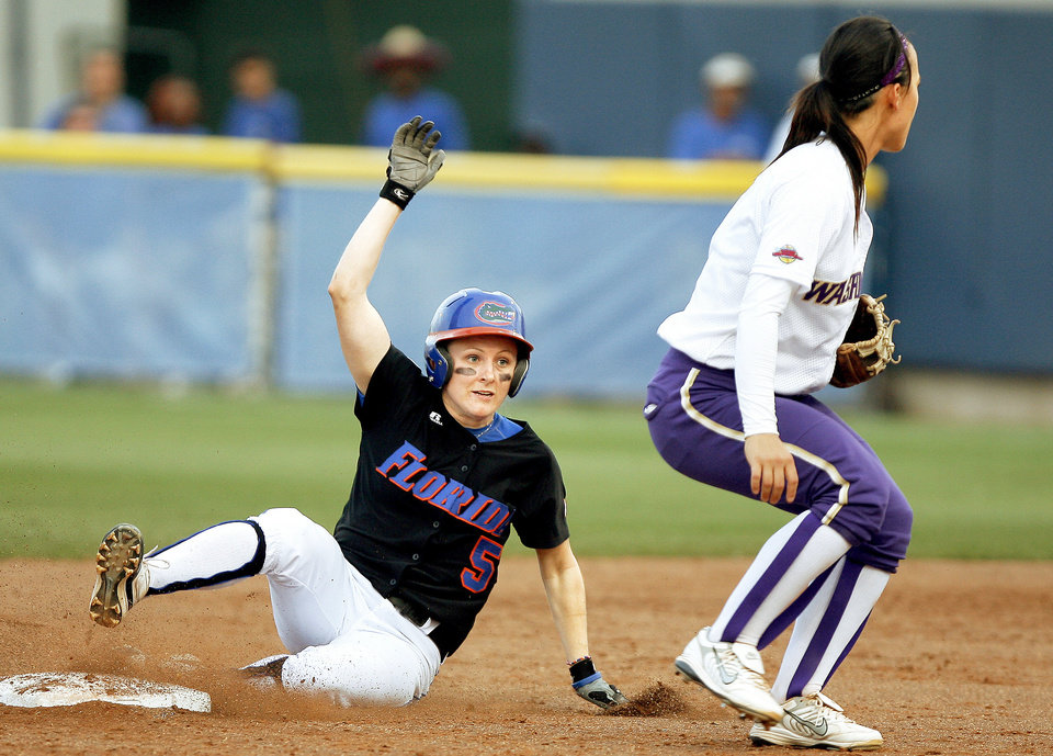 Photo - Florida's Kim Waleszonia, left, slides into second past Washington's Jennifer Salling in the second inning of Game 2 on Tuesday. Photo by Bryan Terry, The Oklahoman