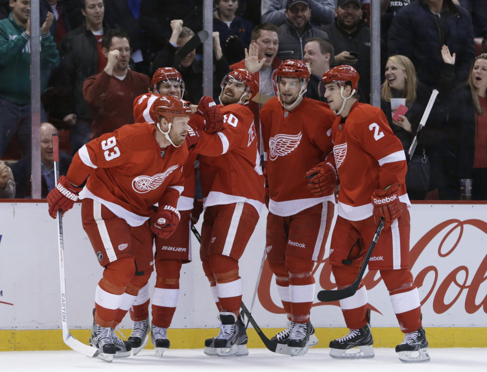 Photo - Detroit Red Wings left wing Johan Franzen (93), of Sweden, is congratulated by teammates after scoring during the second period of an NHL hockey game against the Colorado Avalanche in Detroit, Tuesday, March 5, 2013. (AP Photo/Carlos Osorio)