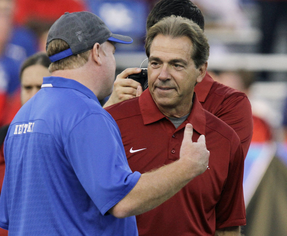 Alabama coach Nick Saban, right chats with Kentucky coach Mark Stoops at midfield before an NCAA college football game in Lexington, Ky., Saturday, Oct. 12, 2013. (AP Photo/Garry Jones) <strong>Garry Jones - AP</strong>