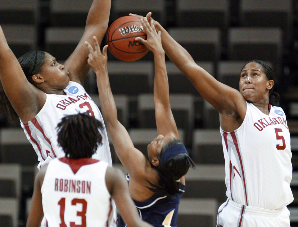 Photo - Courtney and Ashley Paris block a shot by Jacqua Williams in the first half as the University of Oklahoma (OU) plays Georgia Tech in round two of the 2009 NCAA Division I Women's Basketball Tournament at Carver-Hawkeye Arena at the University of Iowa in Iowa City, IA on Tuesday, March 24, 2009. 
