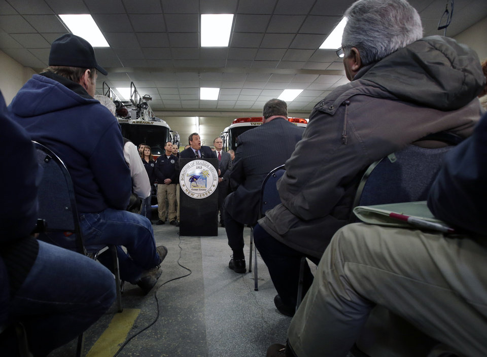 Seaside Heights residents listen as New Jersey Gov. Chris Christie, center, announce his