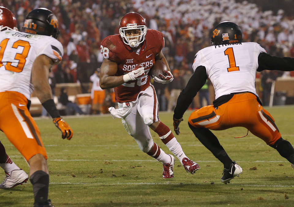 Photo - Oklahoma's Alex Ross (28) runs during a Bedlam college football game between the University of Oklahoma Sooners (OU) and the Oklahoma State Cowboys (OSU) at Gaylord Family-Oklahoma Memorial Stadium in Norman, Okla., Saturday, Dec. 6, 2014. Photo by Bryan Terry, The Oklahoman