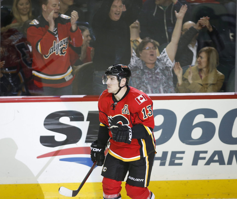 Photo - Calgary Flames' Mike Cammalleri reacts to scoring the winning shootout goal during overtime NHL hockey action against the San Jose Sharks in Calgary, Monday, March 24, 2014. The Flames beat the Sharks 2-1 in a shootout. (AP Photo/The Canadian Press, Jeff McIntosh)