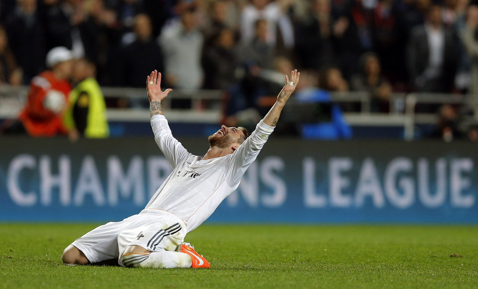Photo - Real's Sergio Ramos gestures on hearing the final whistle, at the end of the Champions League final soccer match between Atletico Madrid and Real Madrid, at the Luz stadium, in Lisbon, Portugal, Saturday, May 24, 2014. (AP Photo/Daniel Ochoa de Olza)