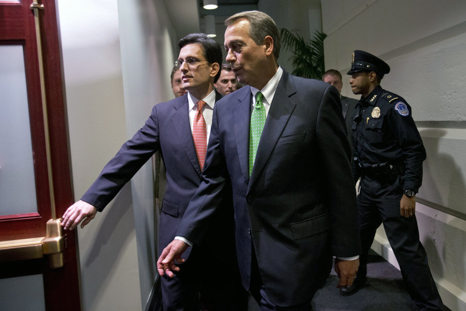 Photo - House Majority Leader Eric Cantor, R-Va., left, with Speaker of the House John Boehner, R-Ohio, enters a second Republican caucus meeting at the U.S. Capitol in Washington, on Tuesday, Jan. 1, 2013. (AP Photo/Jacquelyn Martin)