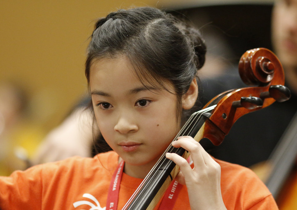 Photo -  Alanna Nguyen concentrates during a recent performance by the El Sistema Oklahoma youth orchestra at St. Luke's United Methodist Church. Photo by Doug Hoke, The Oklahoman   DOUG HOKE -
