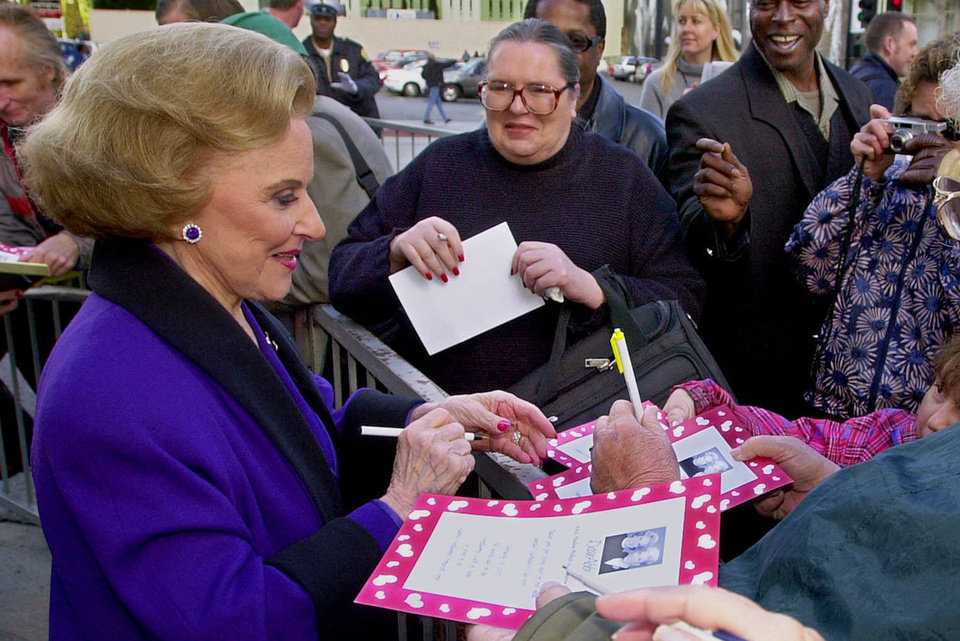 "FILE - In this Feb. 14, 2001 file photo, ""Dear Abby"" advice columnist Pauline Friedman Phillips, 82, known to millions of readers as Abigail van Buren, signs autographs for some of dozens of fans after the dedication of a ""Dear Abby"" star on the Hollywood Walk of Fame in Los Angeles.  Phillips, who had Alzheimer�s disease, died Wednesday, Jan. 16, 2013, she was 94.  Phillips' column competed for decades with the advice column of Ann Landers, written by her twin sister, Esther Friedman Lederer. Their relationship was stormy in their early adult years, but later they regained the close relationship they had growing up in Sioux City, Iowa. The two columns differed in style. Ann Landers responded to questioners with homey, detailed advice. Abby's replies were often flippant one-liners. (AP Photo/Reed Saxon)"
