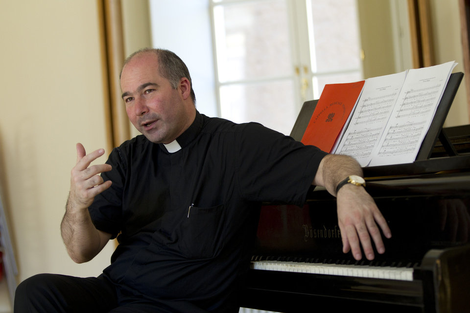 Photo -   The director of the Sistine Chapel Choir, Monsignor Massimo Paolombella talks during an interview with The Associated Press, in Rome, Monday, June 25, 2012. The Westminster Abbey Choir, the world-renown chorus which last year performed at the wedding of Prince William and Kate Middleton, will join the Sistine singers at a special papal Mass on Friday in St. Peter's Basilica, a historic event seen as a perfect symbol of Christian harmony _ after centuries of discord. It's the first time in its 500-plus year history that the pope's personal choir will be accompanied by another chorus, let alone one that comes from the breakaway Anglican Church. (AP Photo/Andrew Medichini)