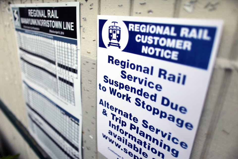 Photo - A sign informs commuters of the work stoppage at the East Falls commuter rail station in Philadelphia on Saturday June 14, 2014. Pennsylvania Gov. Tom Corbett asked President Barack Obama on Saturday to intervene the dispute between the Southeast Pennsylvania Transportation Authority and its engineers and electricians unions, which went on strike at midnight Friday, June 13.  (AP Photo/ Joseph Kaczmarek)