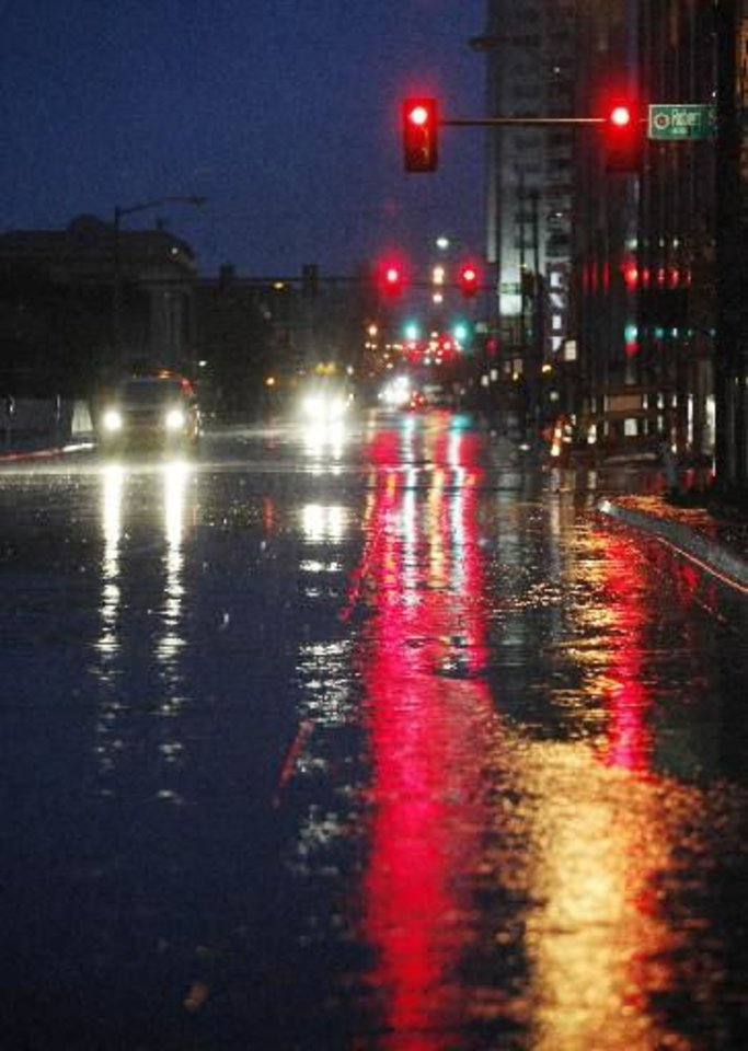 Rain-covered streets before sunrise looking north up Hudson from Park Ave. in Oklahoma City Wednesday, April 10m 2013. Photo by Paul B. Southerland, The Oklahoman