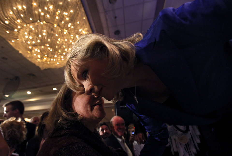 Photo - A supporter whispers congratulations to governor elect Mary Fallin after her win over Jari Askins at the republican Watch Party at the Marriott on Tuesday, Nov. 2, 2010, in Oklahoma City, Okla.   Photo by Chris Landsberger, The Oklahoman