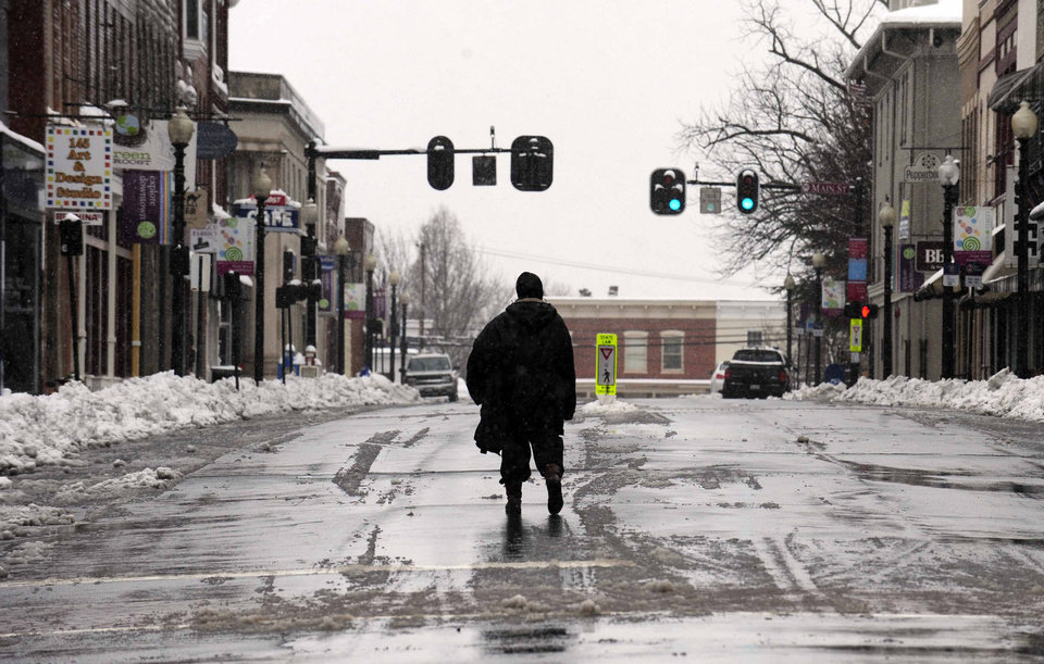 Photo - Downtown Culpeper, Va., was nearly deserted along East Davis St. as power was out to businesses in town Wednesday March 6, 2013.  A snowstorm blanketed the Fredericksburg region closing schools, county governments and roads.  (AP Photo/The Free Lance-Star,Reza A. Marvashti )