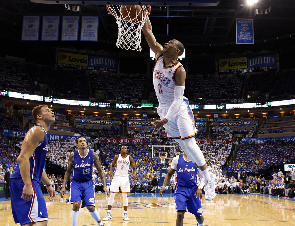 Photo - Oklahoma City's Russell Westbrook (0) dunks in front of Los Angeles' Blake Griffin (32) during Game 2 of the Western Conference semifinals in the NBA playoffs between the Oklahoma City Thunder and the Los Angeles Clippers at Chesapeake Energy Arena in Oklahoma City, Thursday, May 8, 2014. Photo by Sarah Phipps, The Oklahoman