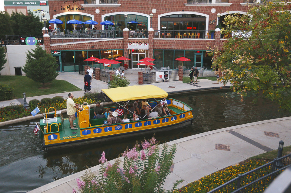 WATER TAXI / BRICKTOWN CANAL: A canal boat travels through Bricktown in Oklahoma City, Friday, Aug. 2, 2013. Photo by Nate Billings, The Oklahoman