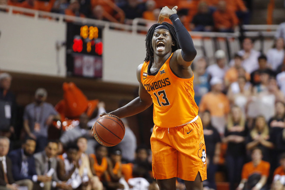 Photo - Oklahoma State's Isaac Likekele (13) shouts during an NCAA basketball game between the Oklahoma State University Cowboys (OSU) and the Oral Roberts Golden Eagles (ORU) at Gallagher-Iba Arena in Stillwater, Okla., Wednesday, Nov. 6, 2019. Oklahoma State won 80-75. [Bryan Terry/The Oklahoman]