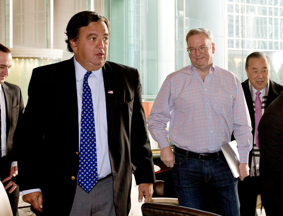 Photo - Google's executive chairman Eric Schmidt, second from right, and former New Mexico Gov. Bill Richardson, left, leave after their meeting at a hotel in Beijing Monday, Jan. 7, 2013. Schmidt, who is part of a delegation led by Richardson, is scheduled to leave Monday on a commercial flight bound for North Korea, a country considered to have the world's most restrictive Internet policies. (AP Photo/Andy Wong)