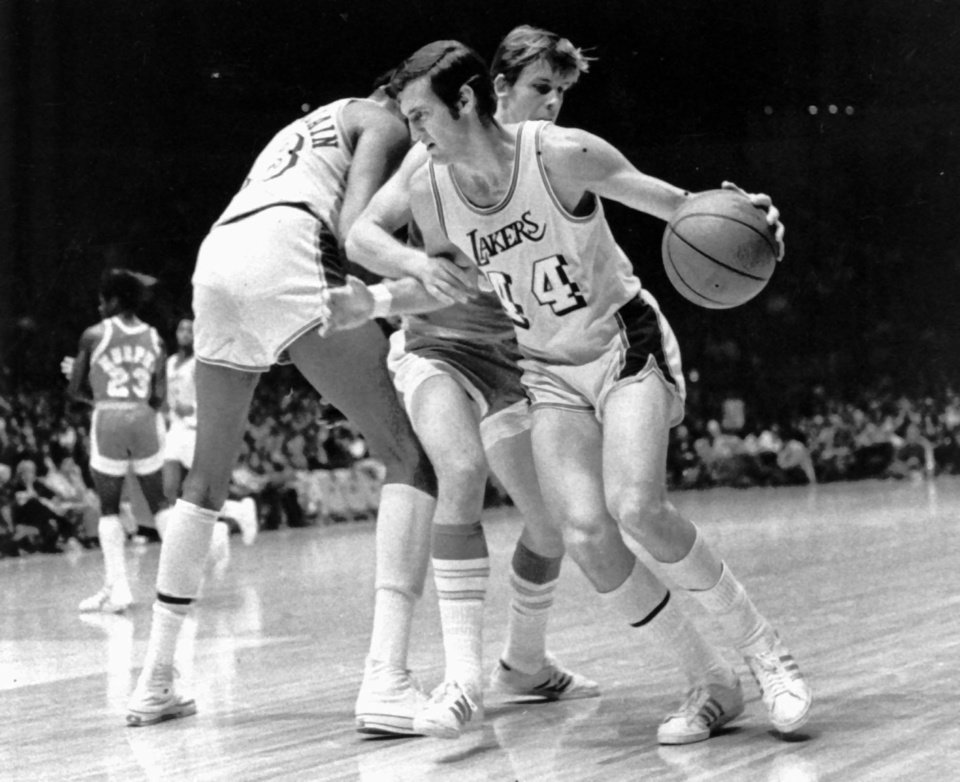Los Angeles Lakers' Jerry West (14) is fouled as he tries to get around Houston Rockets' John Vallely after teammate Wilt Chamberlain set screen in game at the Forum in Inglewood, Calif., on Dec. 27, 1971.  The Lakers went on to their 28th straight win, beating the Rockets 137-115.  (AP Photo) ORG XMIT: APHS199