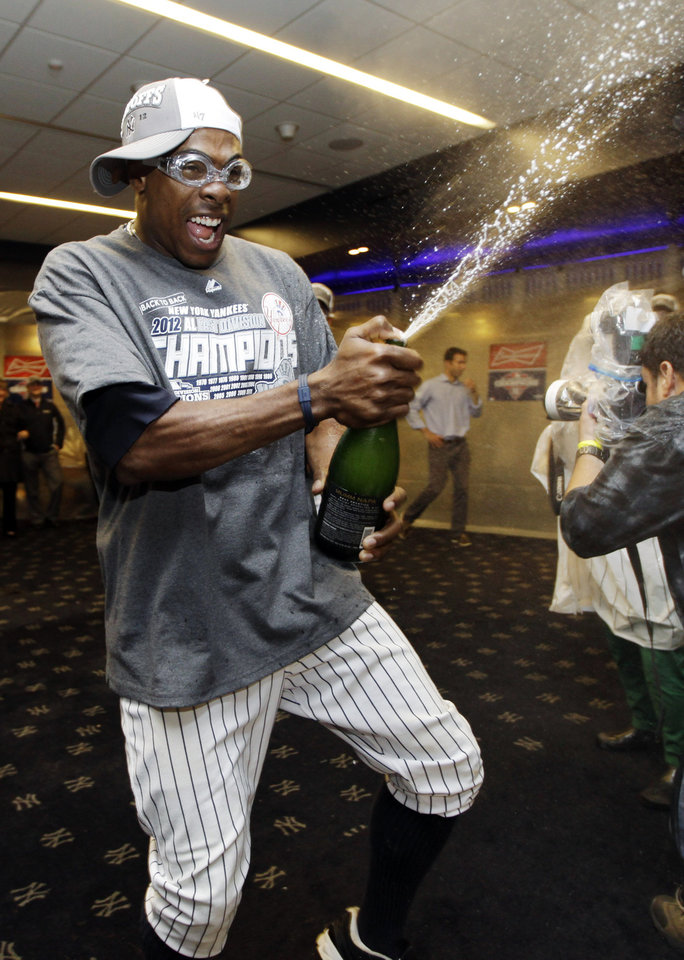 Photo -   New York Yankees' Curtis Granderson celebrates in the clubhouse after their 14-2 win over the Boston Red Sox in a baseball game at Yankee Stadium in New York, Wednesday, Oct. 3, 2012. The Yankees clinched the American League East title. (AP Photo/Kathy Willens)