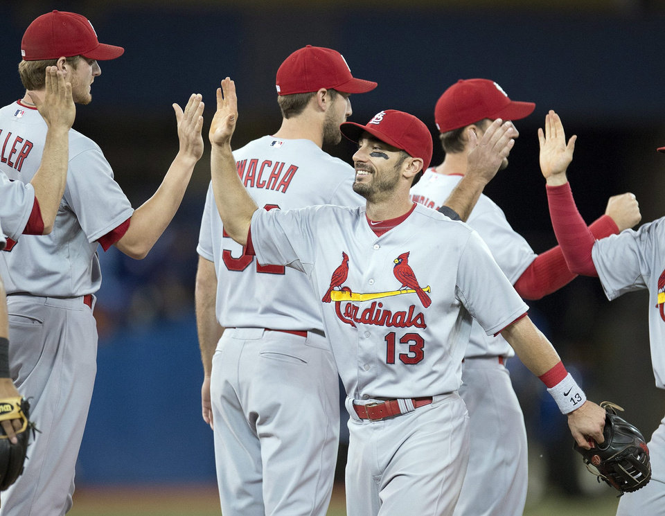 Photo - St. Louis Cardinals Matt Carpenter (13) celebrates with teammates after defeating the Toronto Blue Jays 5-0 in a baseball game in Toronto on Sunday June 8, 2014. (AP Photo/the Canadian Press, Frank Gunn)