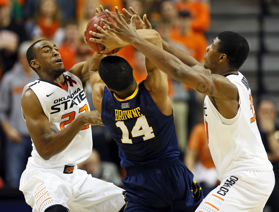Photo - Oklahoma State's Markel Brown (22), left, and Marcus Smart (33) pressure West Virginia's Gary Browne (14) during an NCAA men's basketball game between Oklahoma State University (OSU) and West Virginia at Gallagher-Iba Arena in Stillwater, Okla., Saturday, Jan. 26, 2013. Oklahoma State won, 80-66. Photo by Nate Billings, The Oklahoman