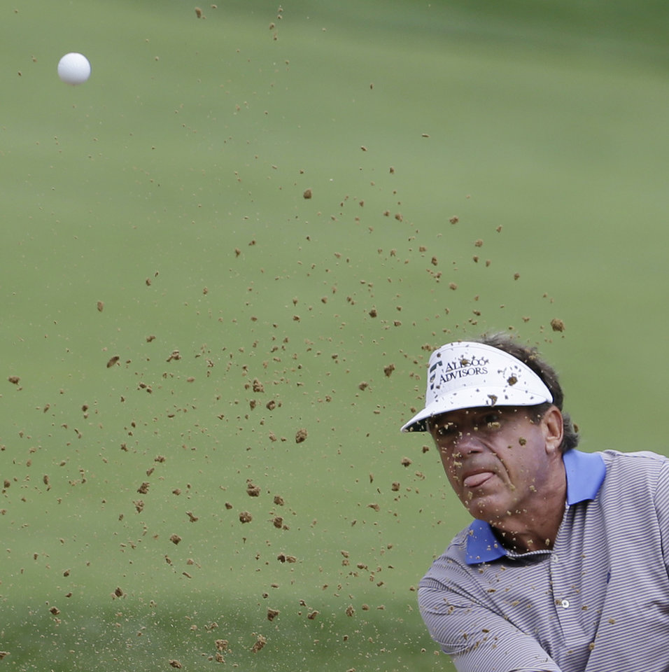Photo - Joey Sindelar watches as he hits out of a bunker on the 18th hole during the second round of the Encompass Championship golf tournament in Glenview, Ill., Saturday, June 21, 2014. (AP Photo/Nam Y. Huh)