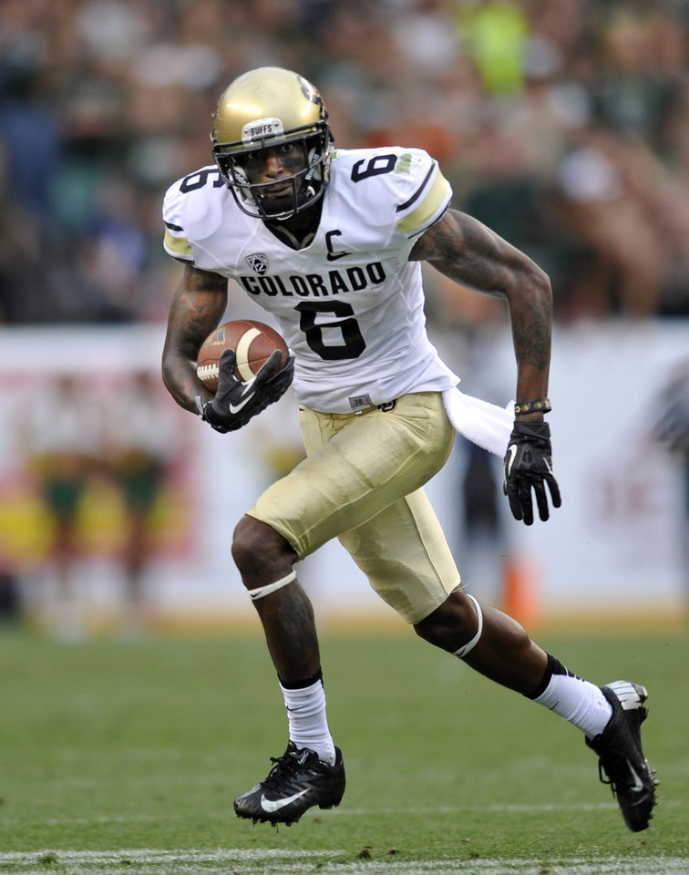 Photo - In this Sept. 1, 2013, file photo, Colorado Buffaloes wide receiver Paul Richardson (6) runs against Colorado State during the second half of an NCAA college football game in Denver. Cousins Shaq and Paul Richardson have been squaring off against each other since they were 8 years old tackling each other in Southern California. On Saturday, Oct. 26,  they'll face each other again when Paul's Colorado Buffaloes host Shaq's Arizona Wildcats. (AP Photo/Jack Dempsey, File)