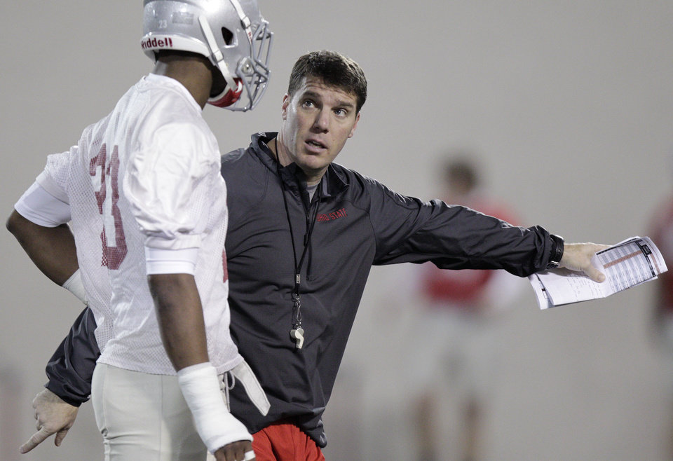 Photo - Ohio State's new co-defensive coordinator and safeties coach Chris Ash instructs defensive back Tyvis Powell during their Spring NCAA college football practice Tuesday, March 4, 2014, in Columbus, Ohio. (AP Photo/Jay LaPrete)