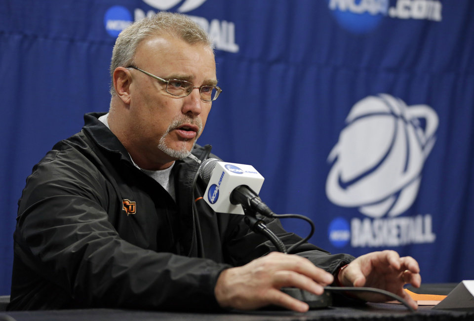 Photo - Oklahoma State head coach Jim Littell answers a question during an NCAA college basketball tournament news conference in West Lafayette, Ind., Sunday, March 23, 2014. Oklahoma State faces Purdue in a second round game on Monday. (AP Photo/Michael Conroy)