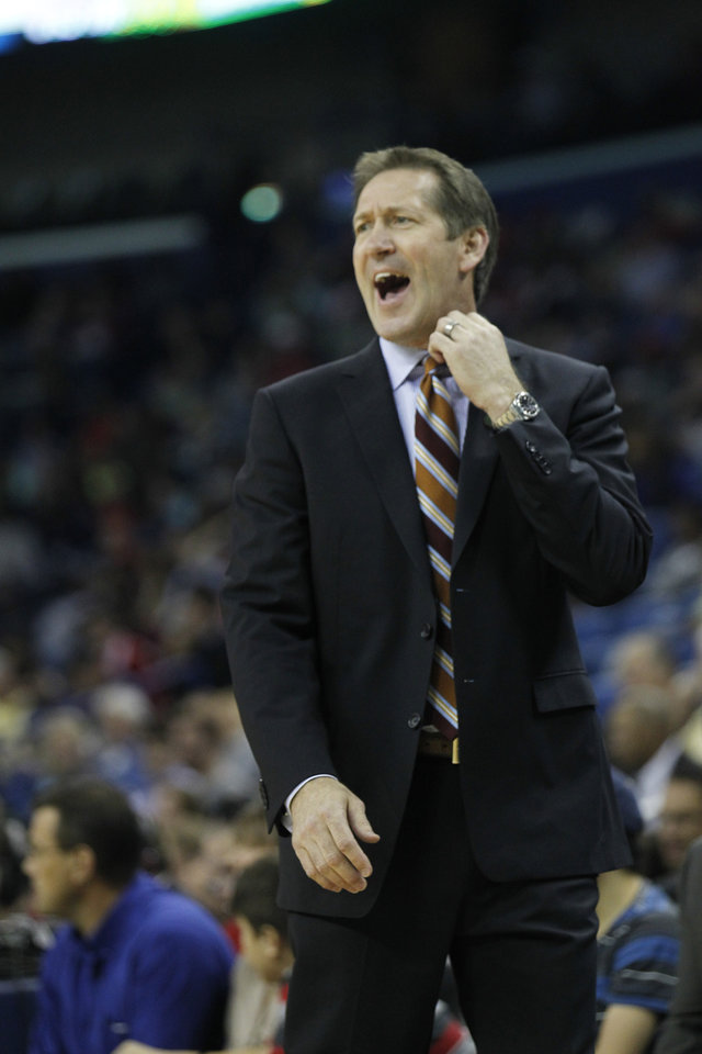 Photo - Phoenix Suns head coach Jeff Hornacek stands on the sideline against the New Orleans Pelicans in the first half of an NBA basketball game in New Orleans, Wednesday, April 9, 2014. (AP Photo/Bill Haber)