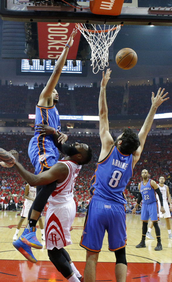 Photo - Oklahoma City's Andre Roberson (21) defends against Houston's James Harden (13) during Game 5 in the first round of the NBA playoffs between the Oklahoma City Thunder and the Houston Rockets in Houston, Texas,  Tuesday, April 25, 2017.  Photo by Sarah Phipps, The Oklahoman