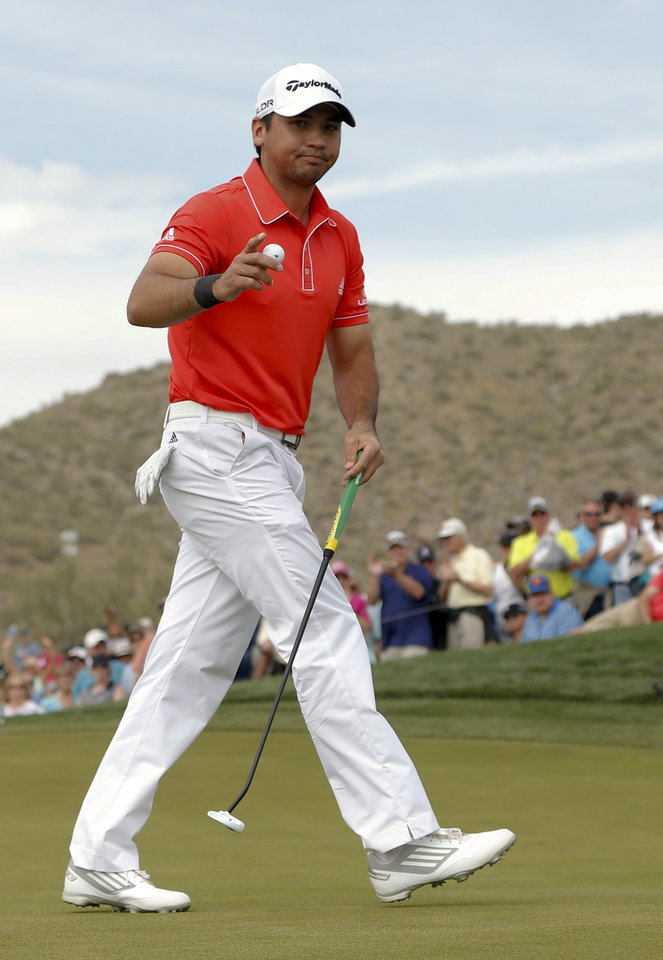 Photo - Jason Day, of  Australia, waves on the eighth hole in his championship match against Victor Dubuisson, of France, during the Match Play Championship golf tournament on Sunday, Feb. 23, 2014, in Marana, Ariz. (AP Photo/Matt York)
