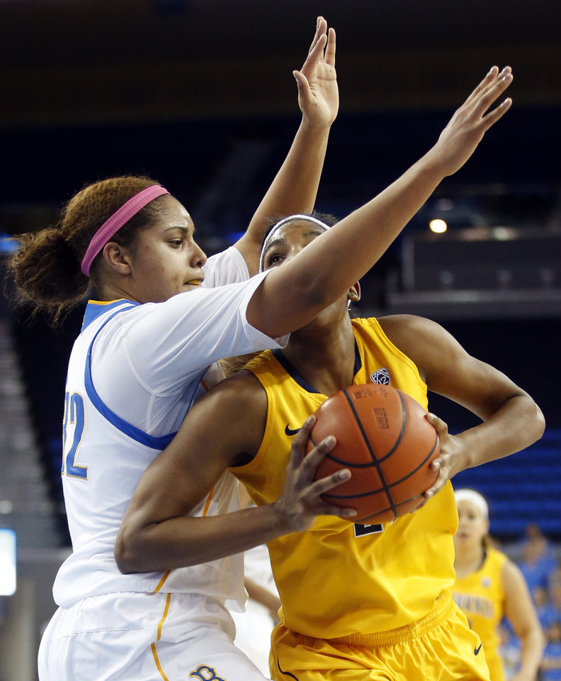 Photo - UCLA forward Alyssia Brewer, left, defends California forward Reshanda Gray during the first half of an NCAA college basketball game in Los Angeles, Friday, Feb. 15, 2013. (AP Photo/Jae C. Hong)