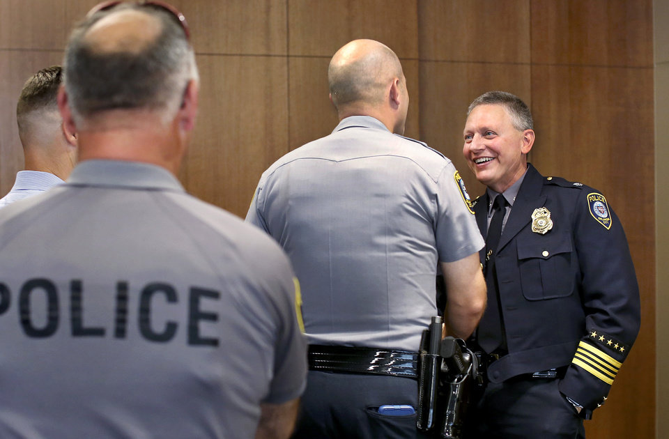 Photo -  Wade Gourley greets officers, commanders and administrative personnel at police headquarters Monday, July 8, 2019, after being introduced by City Manager Craig Freeman as the new chief of the Oklahoma City Police Department. [Jim Beckel/The Oklahoman]