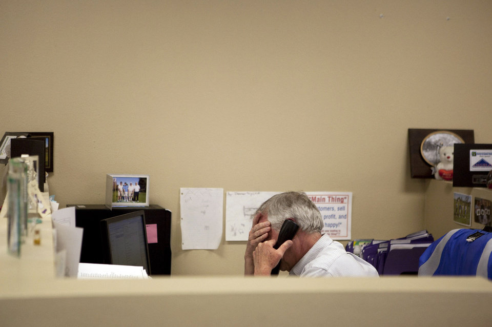 Photo - Steve Wyard, 61, a regional sales director of All Valley Washer Service, talks on the phone in his office recently in the Van Nuys section of Los Angeles. Wyard and his wife have two sons, 19 and 21, to put through college, and they see that pushing back retirement for several years. Until then Wyard plans to keep working. AP Photo  Jae C. Hong