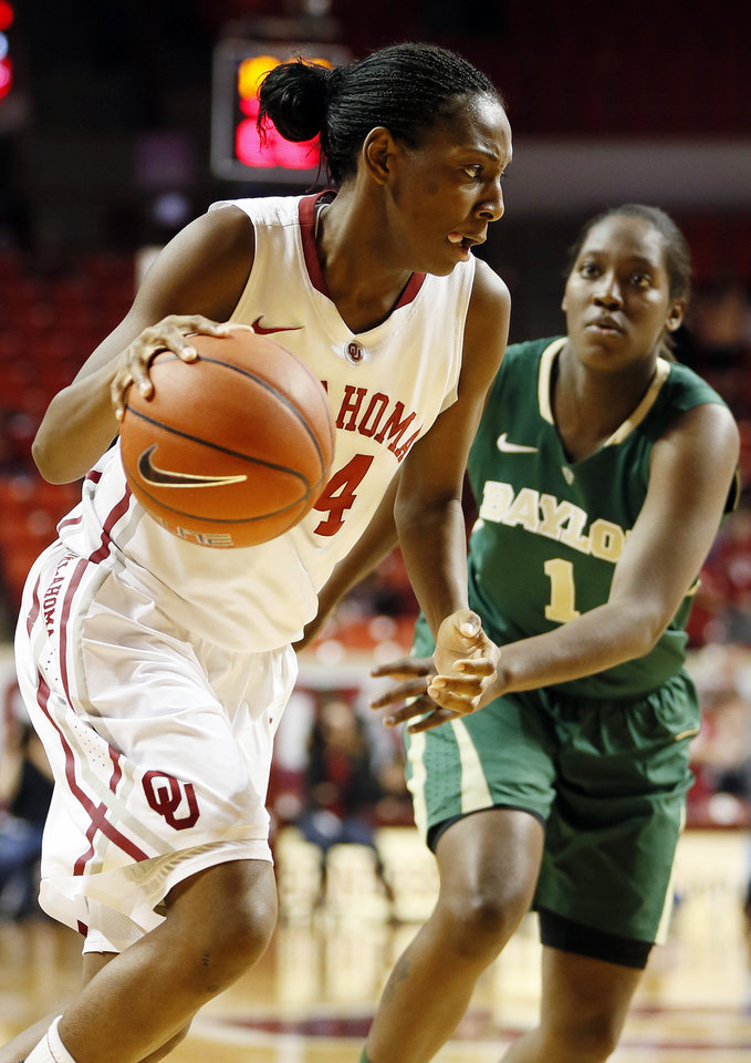 Photo - Oklahoma's Sharane Campbell (24) drives against Baylor's Kimetria Hayden (1) during a women's college basketball game between the University of Oklahoma and Baylor at the Lloyd Noble Center in Norman, Okla., Monday, Feb. 25, 2013. Baylor beat OU, 86-64. Photo by Nate Billings, The Oklahoman