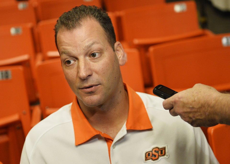 Photo - Oklahoma State offensive coordinator Mike Yurcich addresses media members at a media availability session inside Gallagher-Iba Arena on Thursday, August 21, 2014. Photo by KT King/For the Oklahoman