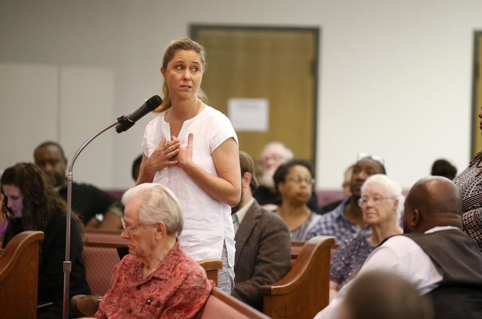 Photo - Shannon Hazen, whose daughter Kirsten Hatfield was murdered, asks a question during a public forum about unsolved homicides hosted by The Oklahoman at Prospect Baptist Church in Oklahoma City, Tuesday, July 26, 2016. Photo by Bryan Terry, The Oklahoman